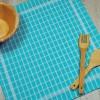 Torchon de cuisine bleu turquoise en tissu 100% coton.